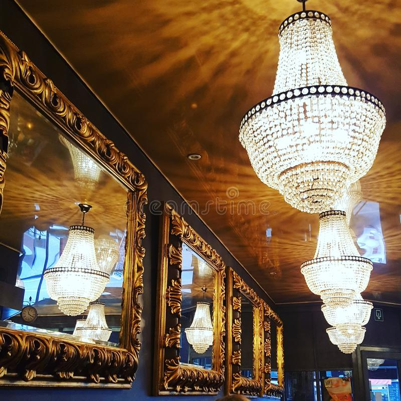 Chandeliers and mirrors stock photo