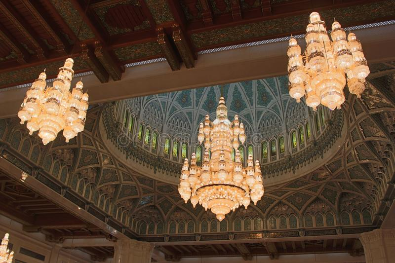The Chandeliers of the Sultan Qaboos Grand Mosque. The largest chandelier in the world adorns the Sultan Qaboos Grand Mosque in Muscat, Oman. It weighs 8.5 tons stock photography