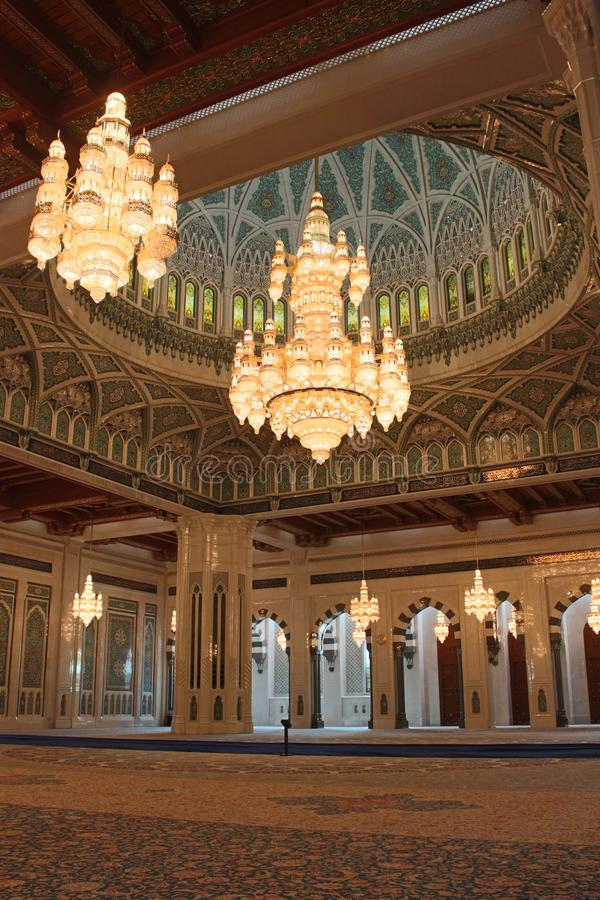 The Chandeliers of the Sultan Qaboos Grand Mosque. The largest chandelier in the world adorns the Sultan Qaboos Grand Mosque in Muscat, Oman. It weighs 8.5 tons stock image