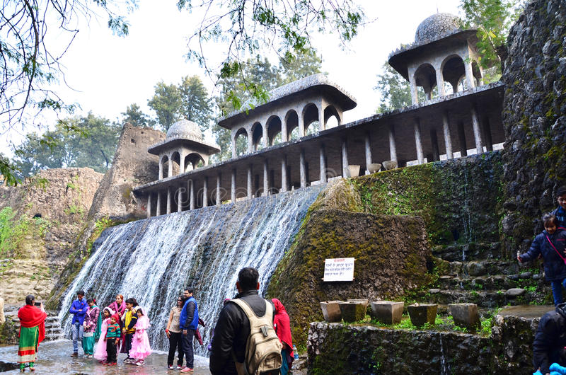Chandigarh, India - January 4, 2015: People visit rock garden in Chandigarh. Chandigarh, India - January 4, 2015: People visit Rock statues at the rock garden on stock photos