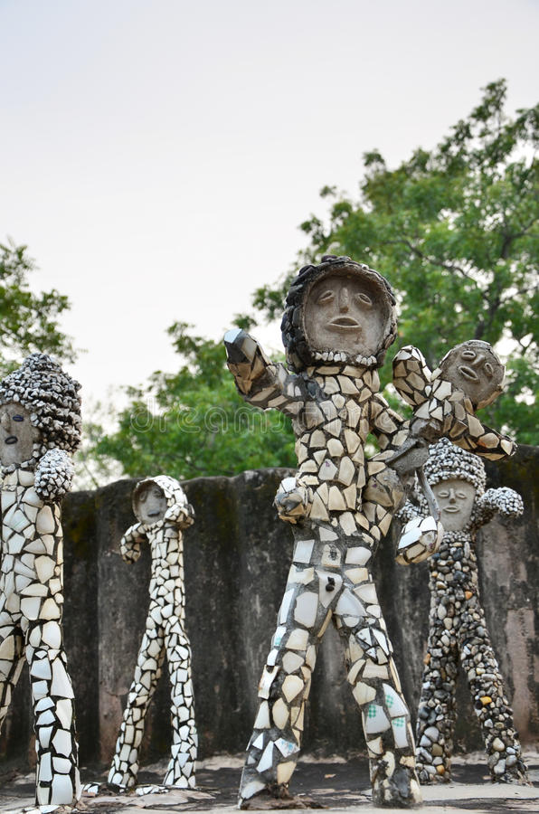 Chandigarh, India - January 4, 2015: Rock statues at the rock garden in Chandigarh. Chandigarh, India - January 4, 2015: Rock statues at the rock garden on stock images
