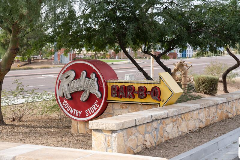 Rudy`s Barbecue neon sign in Chandler Arizona. Chandler, AZ - Dec. 2, 2019: Neon sign in front of Rudy`s Country Store and Bar-B-Q stock photos