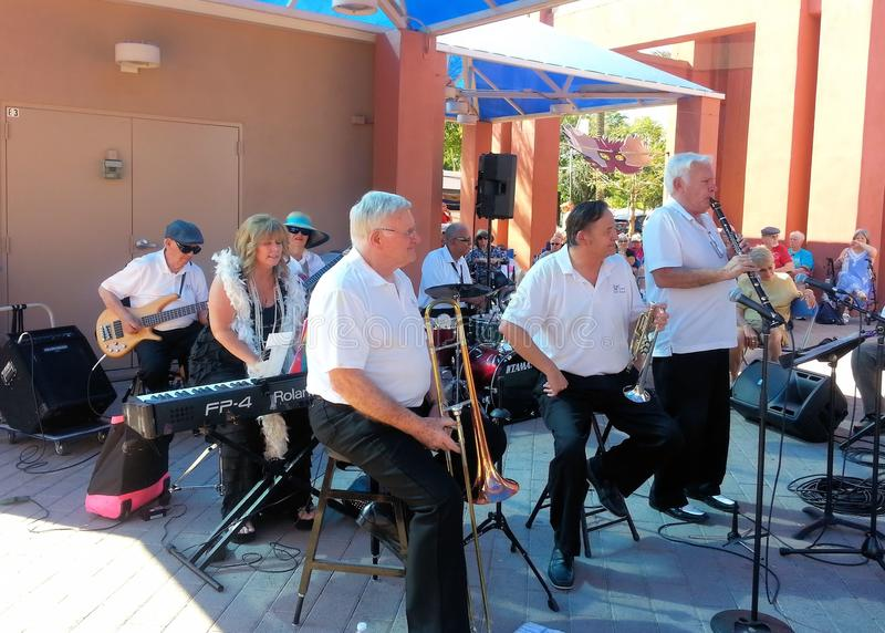 CHANDLER, AZ/USA - MARCH 28: 52nd Street Jazz Band performs at the Chandler Jazz Festival. Gary Church, Joe Hopkins, Ernie Landes, Cheryl Thurston, Danny stock images