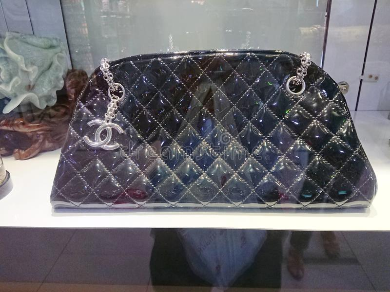Chanel bags. Black Chanel bags on display at a pre-own reseller store in Singapore stock images