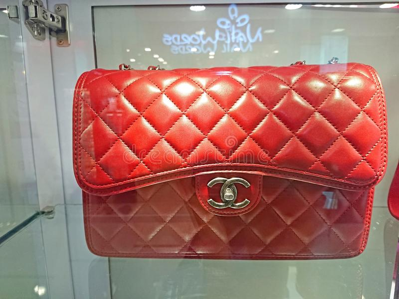 Chanel bags. Red Chanel bags on display at a pre-own reseller store in Singapore stock photos