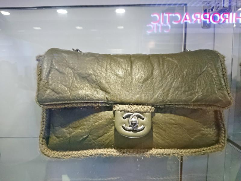 Chanel bags at window display. Chanel bags on display at a pre-own reseller store in Singapore royalty free stock photos