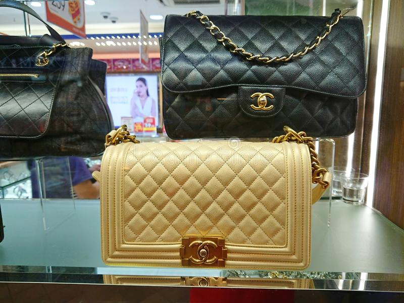 Chanel bags at window display. Chanel bags on display at a pre-own reseller store in Singapore stock photography