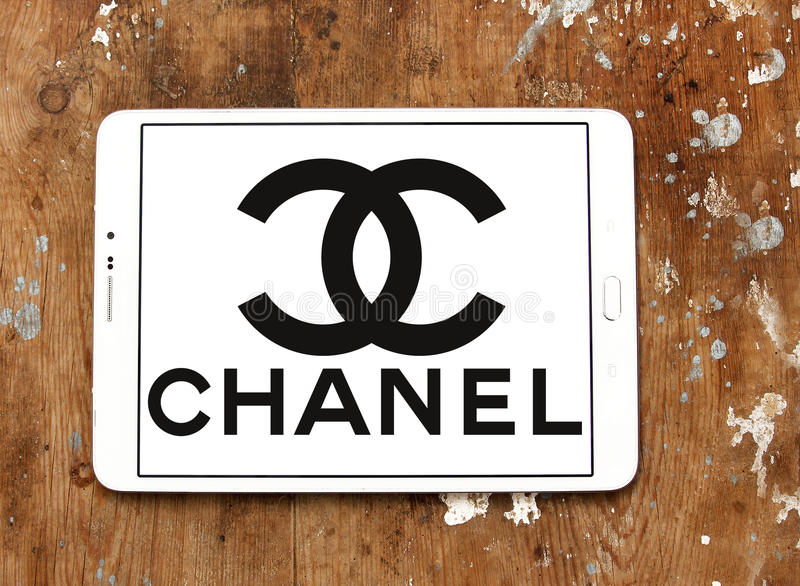 Chanel logo. Logo of fashion company chanel on samsung tablet on wooden background royalty free stock photos
