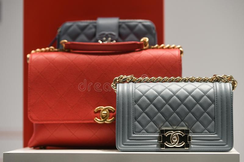 Chanel luxury accesories and clothing in a store in Milan. Milan, Italy - February 22, 2019:  Chanel luxury accesories and clothing in a store in Milan stock image
