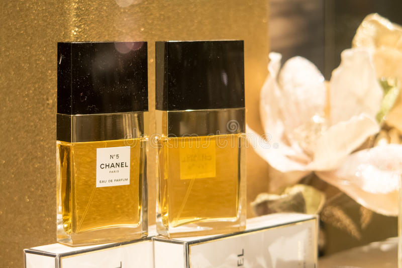 Chanel No5. Chanel No 5 perfume in a perfumery shopping window with copy space to the right royalty free stock photography