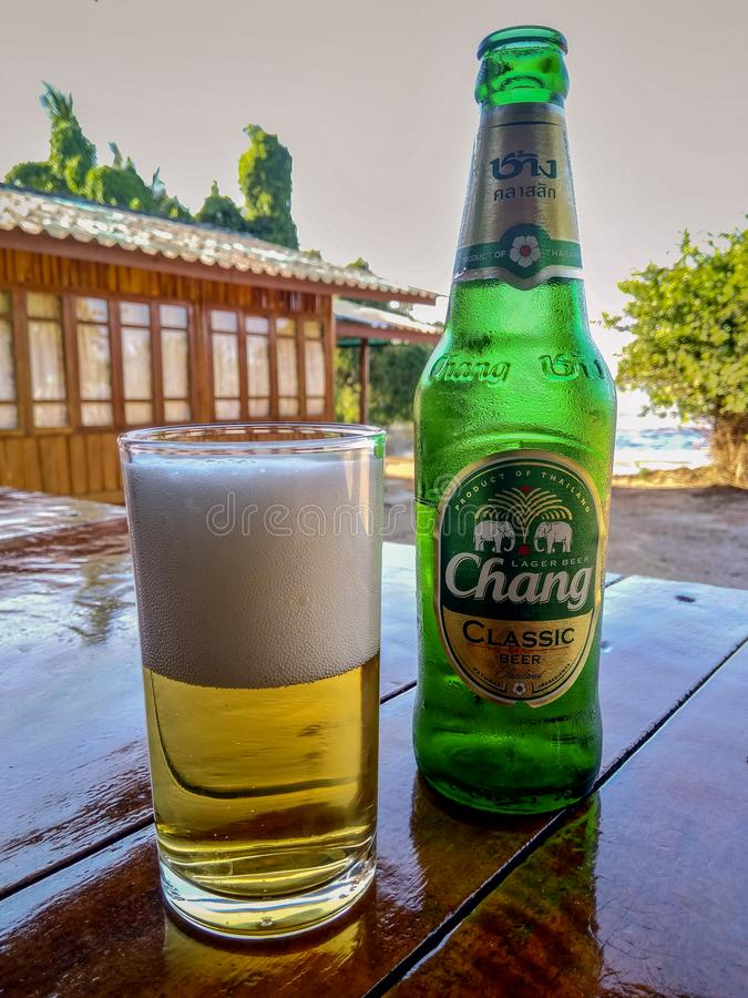 Chang beer bottle and glass full of beer on the table stock photos