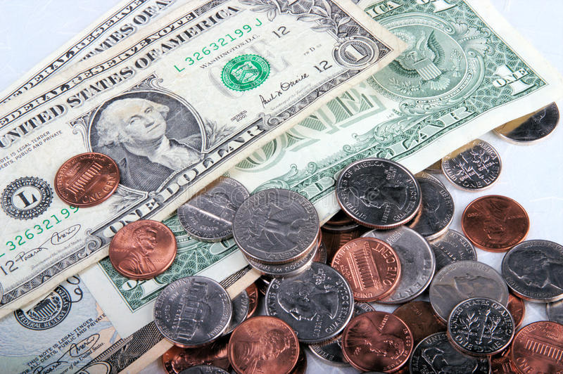 Change. Close-up of some change money, one dollars bills and coins royalty free stock photos