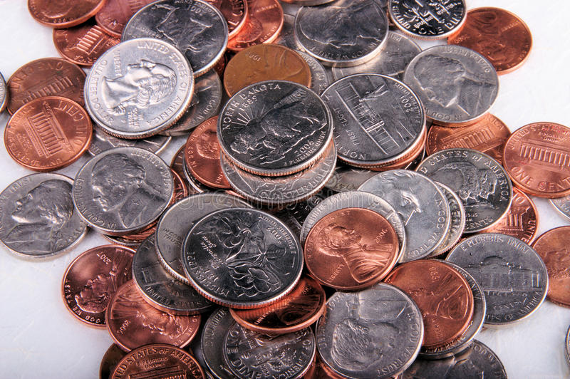 Change. Close-up of some change money, quarters and other coins royalty free stock photography