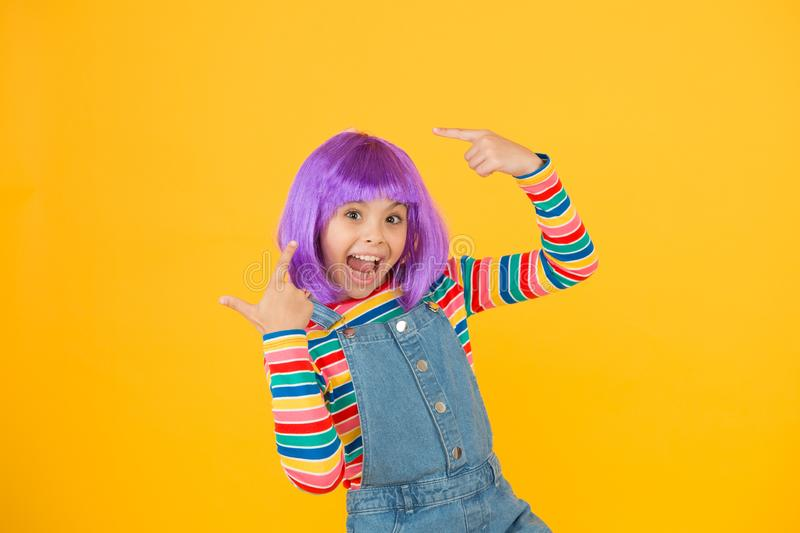 Change color. Fantasy hair trend. Kid girl with bright vibrant hairstyle. Artificial wig concept. Pigment dye hair. Growing freedom for self expression stock images