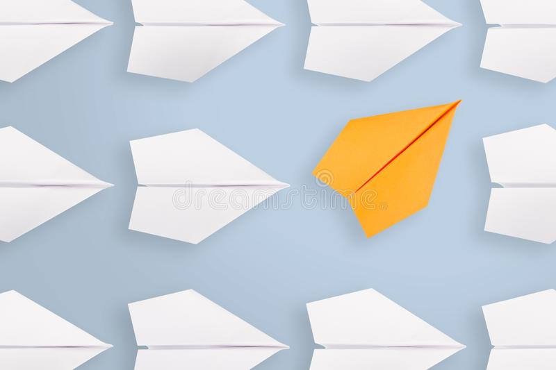 Change concepts with orange paper airplane. Business working concepts royalty free stock photos