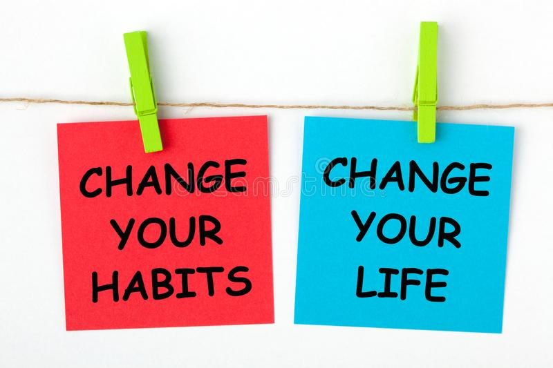 Change Habits Change Life. Change Your Life by Changing Your Habits text written on color notes with wooden pinch royalty free stock photography