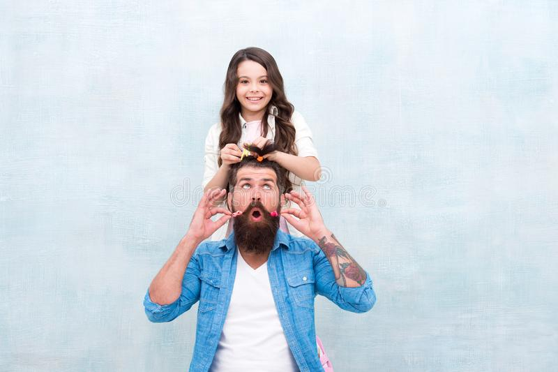 Change hairstyle. Daughter hairstylist. Enjoy fatherhood. Happy moment. Raising girl. Create funny hairstyle. Child royalty free stock images