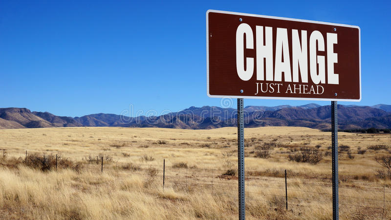 Change Just Ahead brown road sign stock photo