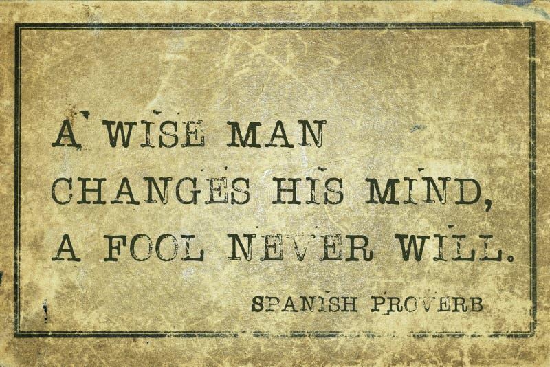 Change mind SP. A wise man changes his mind - ancient Spanish proverb printed on grunge vintage cardboard royalty free illustration