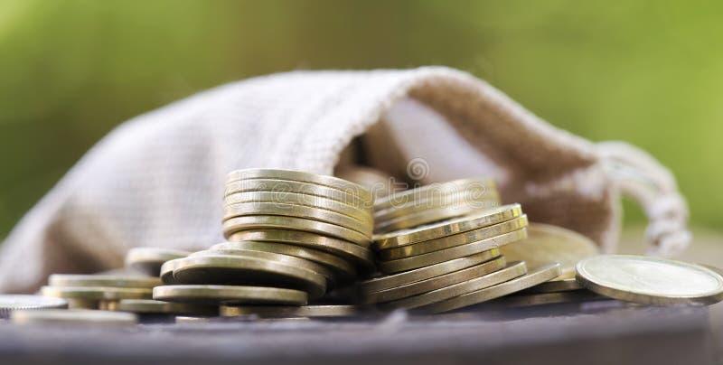 Change money banner of gold coins. Change money - web banner of gold coins with bag - close-up stock photos