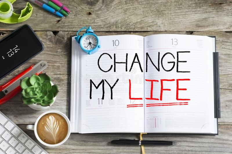 Change my life, personal goal or resolution for the new year handwritten on agenda royalty free stock image