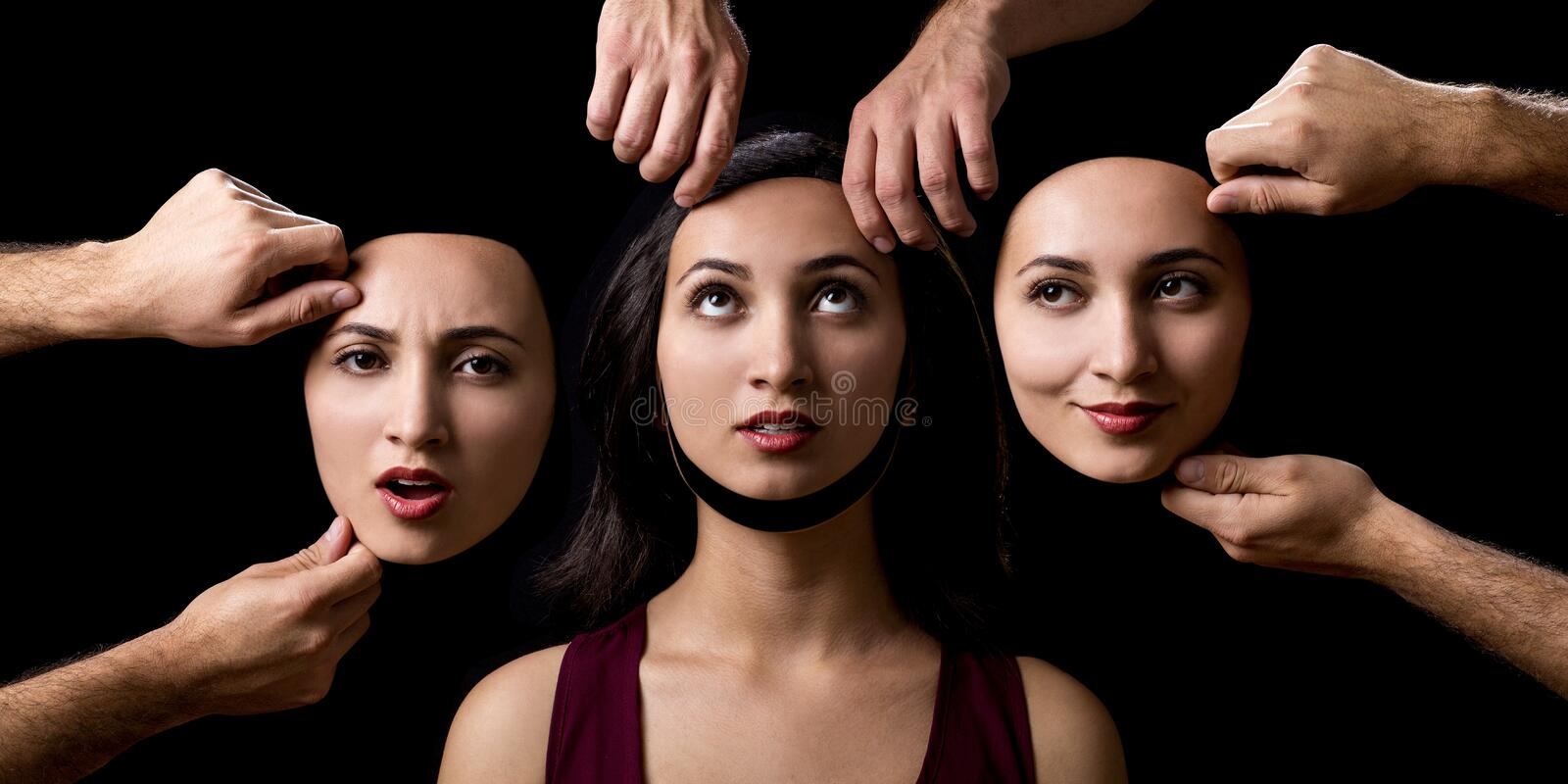 Change of personality on black background royalty free stock photo