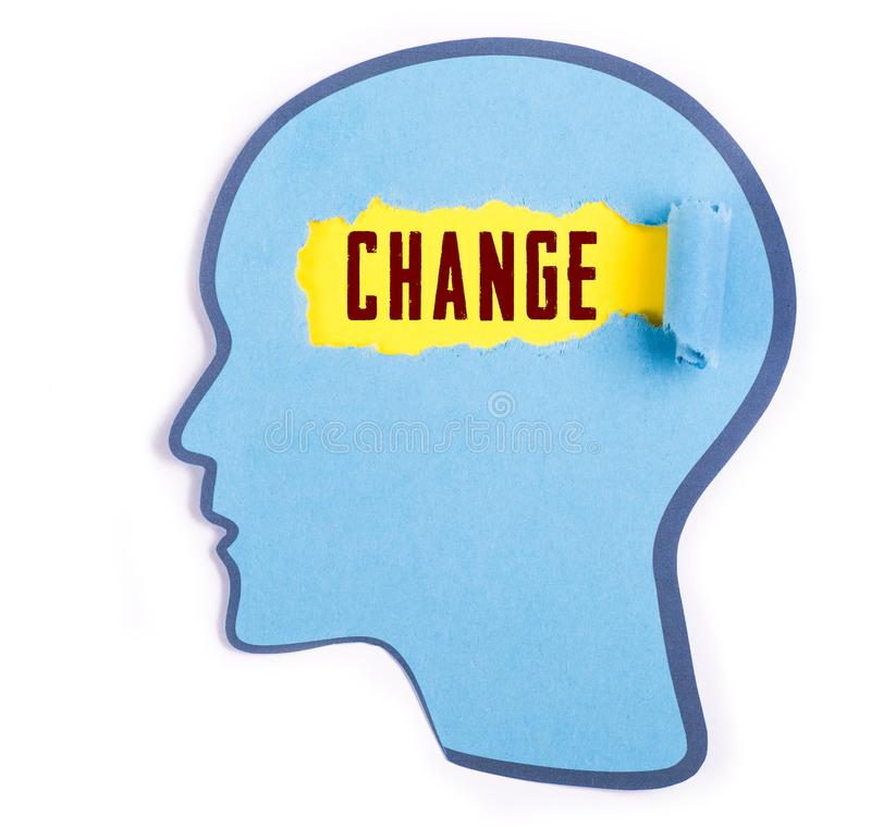 Change word in the person head. Torn blue paper and Paper head concept Thoughts inside the brain stock photo