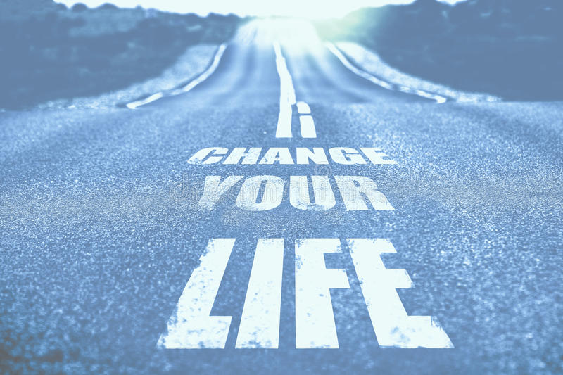 Change your life written on road. Toned. stock images