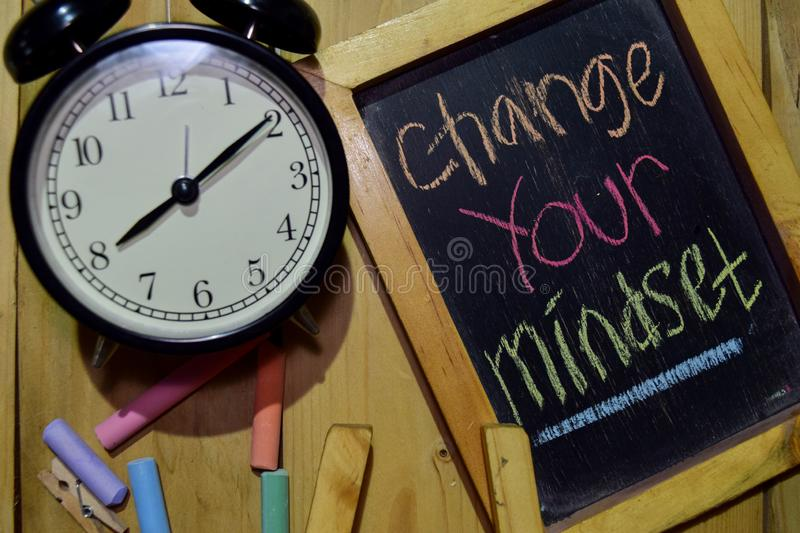 Change Your Mindset on phrase colorful handwritten on chalkboard stock photography