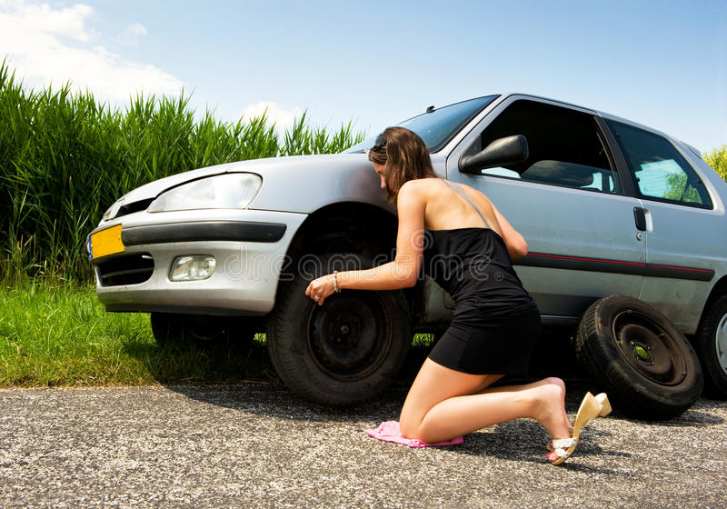 Changing A Flat Tire Royalty Free Stock Photo