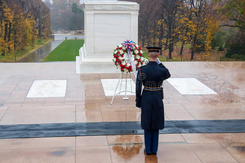 Changing the guard at Arlington national Cemetery in Washington. Arlington, USA - November 16, 2011: Soldier salutes - changing the guard in the afternoon at the royalty free stock photos