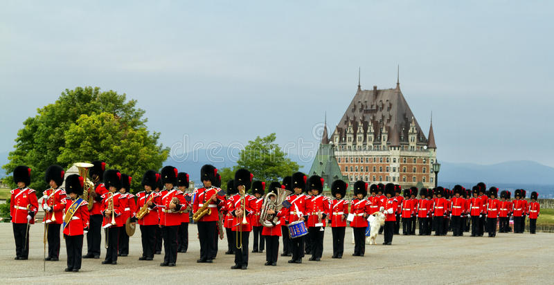 Changing of the Guard. The changing of the guard ceremony at the citadelle in Quebec city with the Chateau Frontenac in the background royalty free stock photo