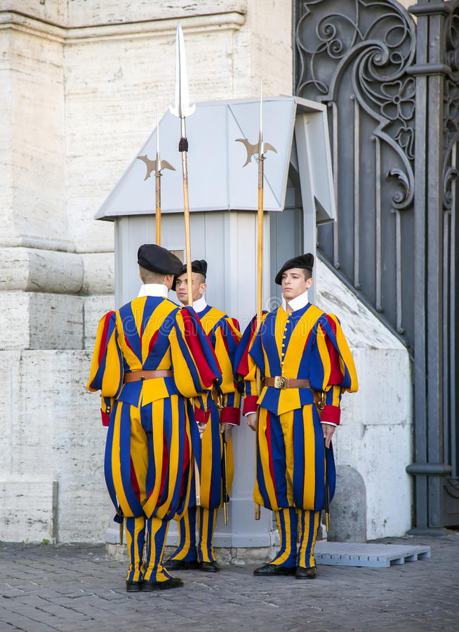 Changing of guard famous Swiss Guard in Vatican. ITALY, VATICAN CITY, OCTOBER, 28, 2014 - Changing of guard famous Pontifical Swiss Guard in Vatican, Italy. The royalty free stock photos