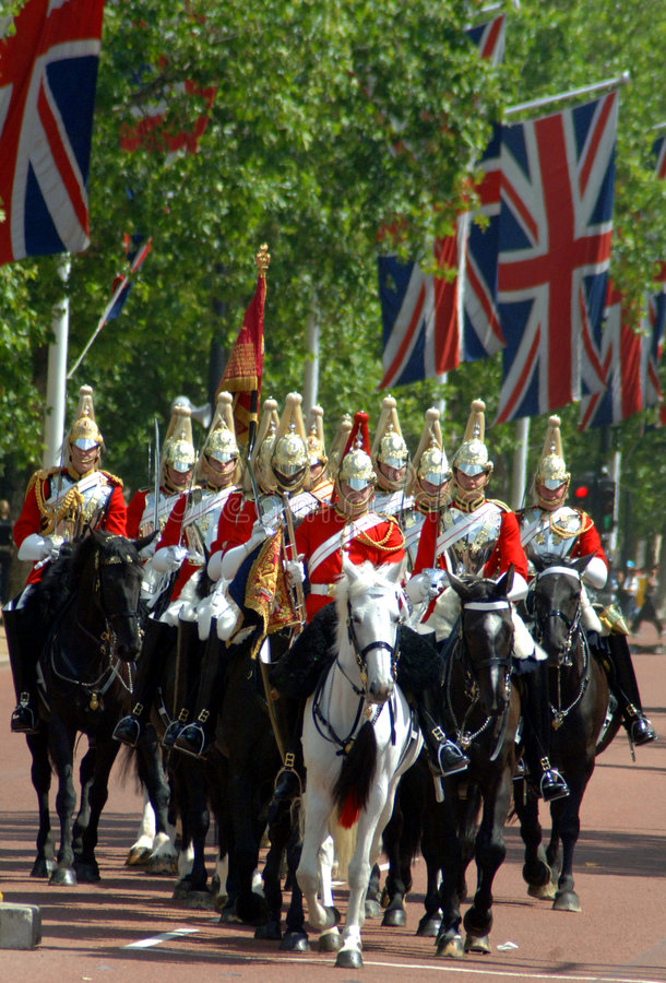 Changing of the guard, London. Soldiers arrive on horseback for the changing of the guard at Buckingham Palace in London