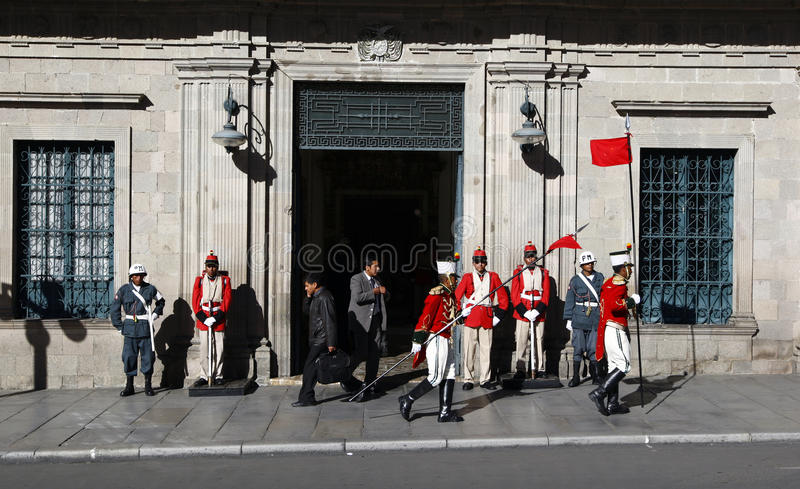Changing of the guards outside the Palacio Quemado which is a popular name to denote the Bolivian Palace of Government. The building is located on Plaza stock photography