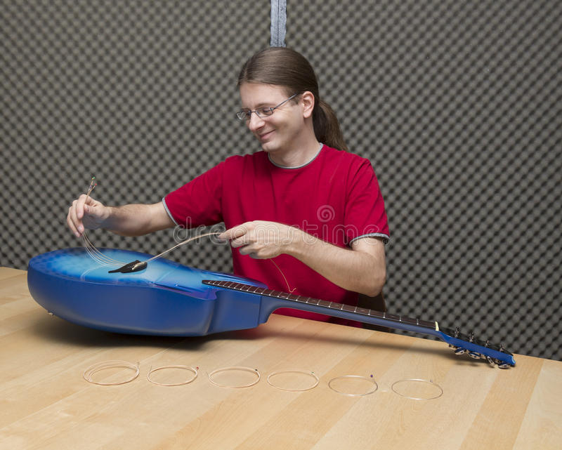Changing the guitar strings royalty free stock image