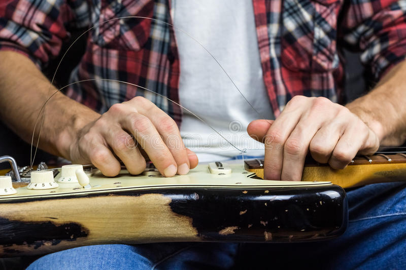 Changing guitar strings royalty free stock image