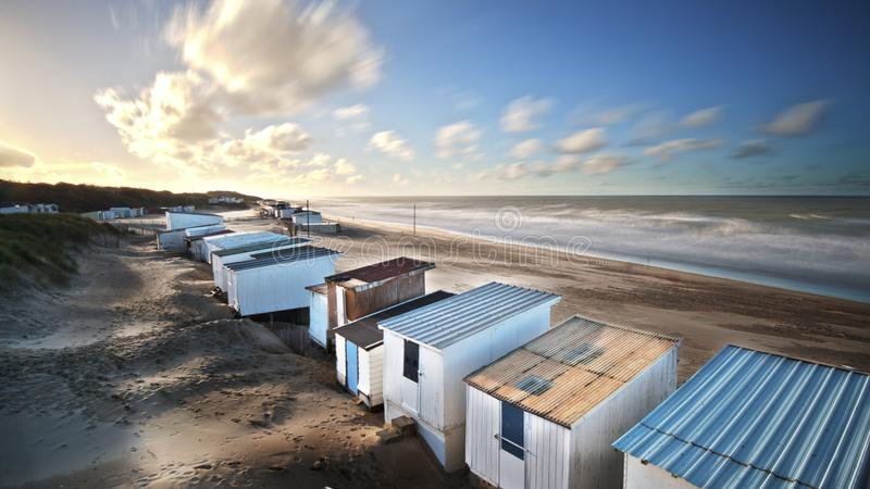 Changing huts on an empty beach