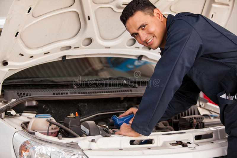 Download Changing oil of a car stock photo. Image of male, latin - 33750454