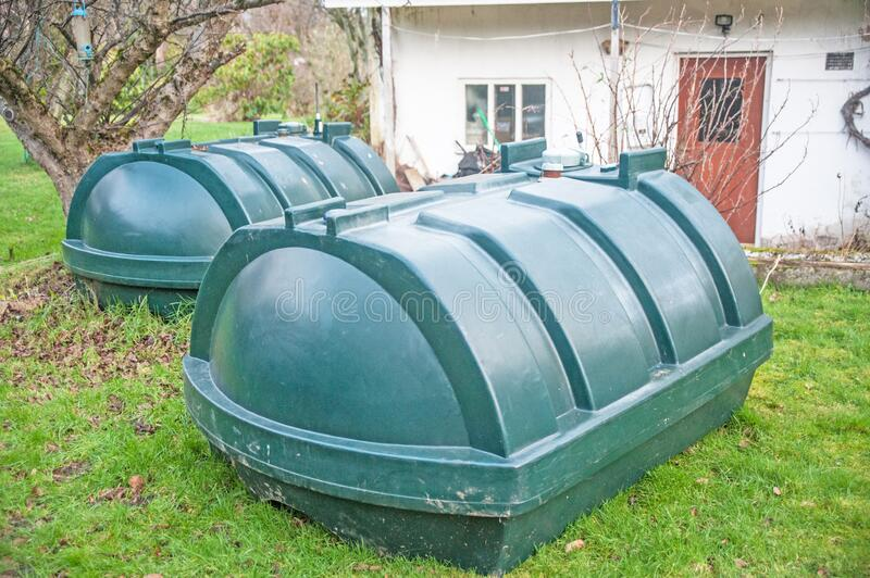 Changing oil tanks in Winter stock photo