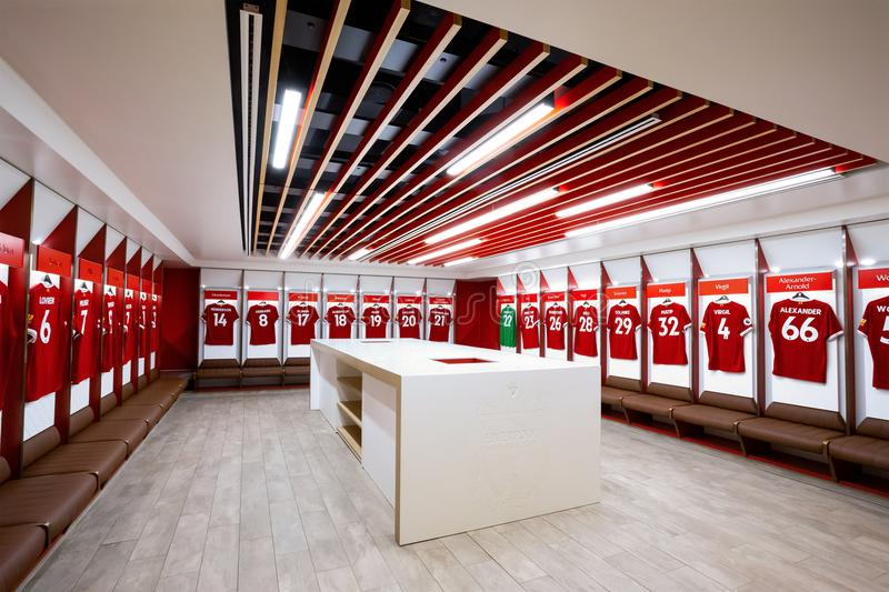 The Changing room at Anfield stadium in Liverpool, UK. LIVERPOOL, UNITED KINGDOM - MAY 17 2018: Player`s jerseys hung in fornt of lockers in the changing room at stock photos