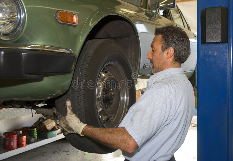 Changing a tire stock image