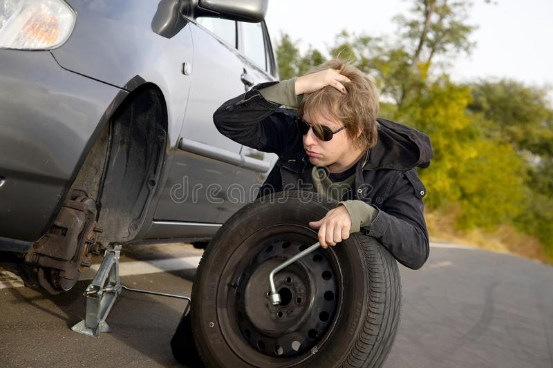 Download Changing tires stock photo. Image of outdoors, mechanic - 27509648