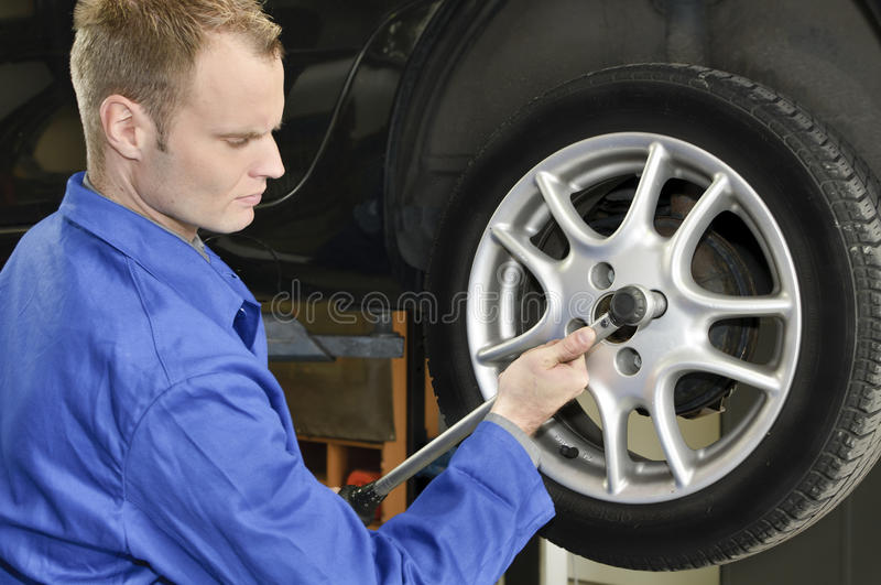 Changing tires in the garage stock images