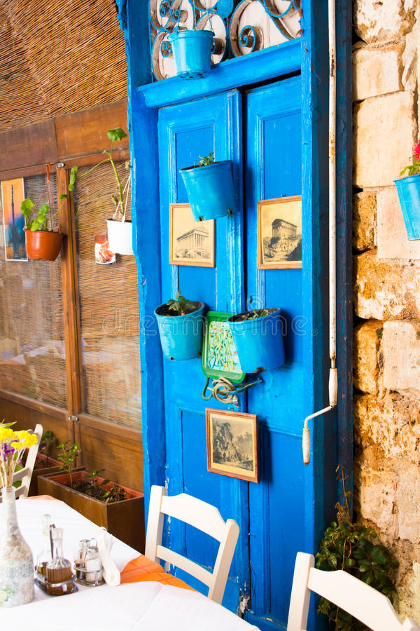 Chania, Crete, Greece - JUNE 24, 2017: pictorial details of Greece - old door - retro styled picture. Frames royalty free stock photo