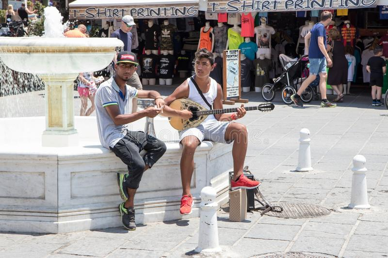 Chania, Crete, Greece - June 27, 2017: Street musicians perform in the streets of Chania, Crete. Island royalty free stock photo