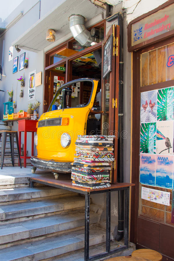 Chania, Crete, Greece - JUNE 24, 2017: Yellow Cafe in the form of a car in the street in Greece, Crete, Chania. Chania, Crete, Greece - JUNE 24, 2017: Yellow royalty free stock images