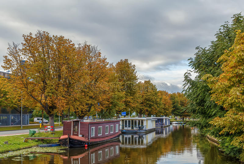 Channel with barges, Leiden, Netherlands. Channel with barges for housing in Leiden, Netherlands stock image