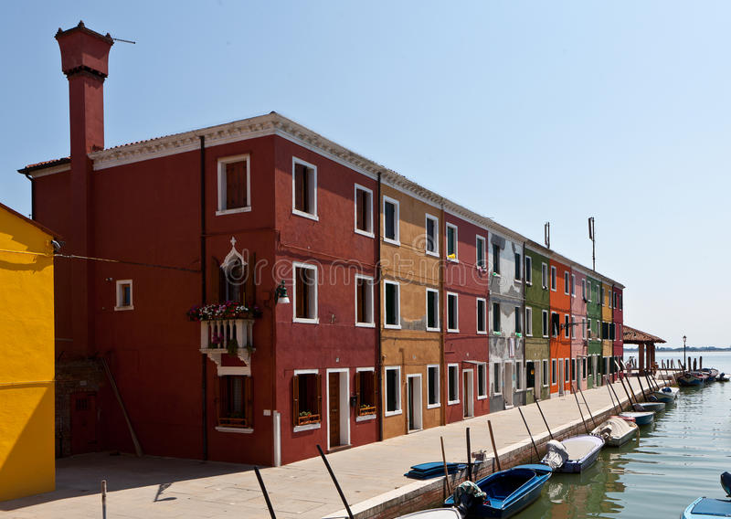 Channel with houses in Burano, Italy royalty free stock photos