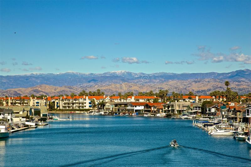 Channel Islands Harbor Oxnard California. Beautiful blue water with motor boat in Channel Islands Harbor Oxnard California royalty free stock photo